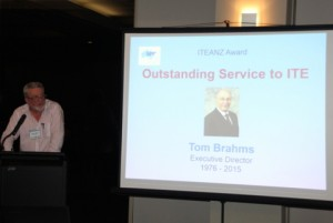 Andrew O'Brien presenting the 'Outstanding Service to ITE' award to Tom Brahms