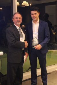Manuel Lawrence accepts the award from ITEANZ President, Nick Szwed