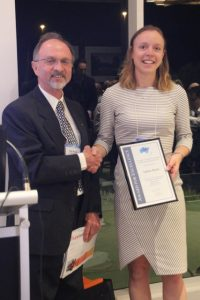 Laura Aston receives her award from President Nick Szwed